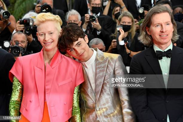 """British actress Tilda Swinton, French-Us actor Timothee Chalamet and Us director Wes Anderson pose as they arrive for the screening of the film """"The..."""