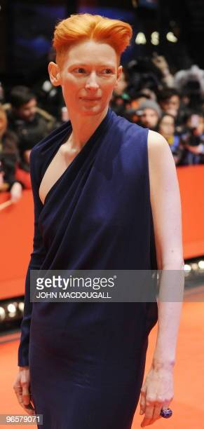 British actress Tilda Swinton poses for photographers as she arrives for the premiere of the film Apart Together competing in the 60th Berlinale Film...