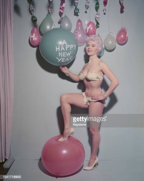 British actress Vera Day holds up a Happy New Year balloon circa 1960
