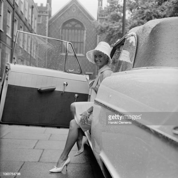 British actress Vera Day stepping out of a car UK 12th July 1961