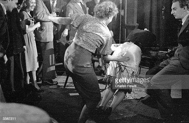 British actress Vida Hope getting her bottom smacked by Rosalyn Boulter in a scene from the film 'For Them That Trespass' Original Publication...