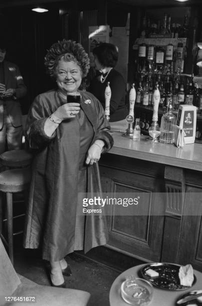 British actress Violet Carson celebrates her OBE with a pint at the Old Bell pub on Fleet Street in London UK 21st October 1965 She received her...