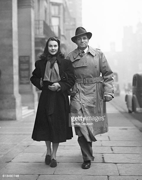 British actress Vivian Leigh walks down a London street with her husband actor Laurence Olivier during the 1940s Leigh became popular in her...