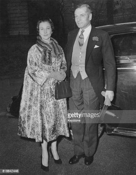 British actress Vivien Leigh and her husband actor Laurence Olivier arrive at Holy Trinity Church in London for the wedding of Miss Leigh's daughter...