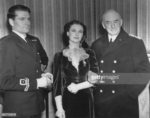 British actress Vivien Leigh and her husband actor Laurence Olivier of the Fleet Air Arm with Sir Dudley Pound the First Sea Lord at a charity...