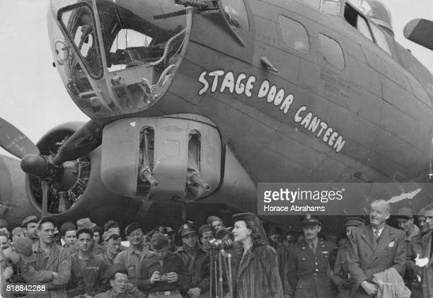 British actress Vivien Leigh speaks at the christening of US B17 Flying Fortress 'Stage Door Canteen' watched by her husband actor Laurence Olivier...