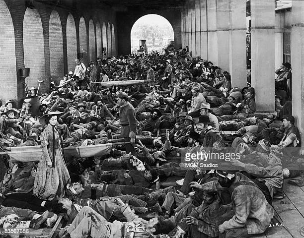 British actress Vivien Leigh stands among Atlanta's wounded in a still from the film 'Gone with the Wind' directed by Victor Fleming 1939