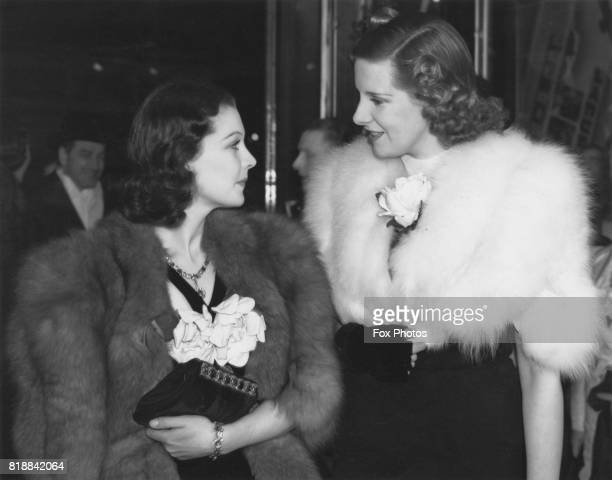 British actress Vivien Leigh with actress Leonora Corbett during a premiere of the film 'The Vessel of Wrath' at The Regal Marble Arch London 24th...