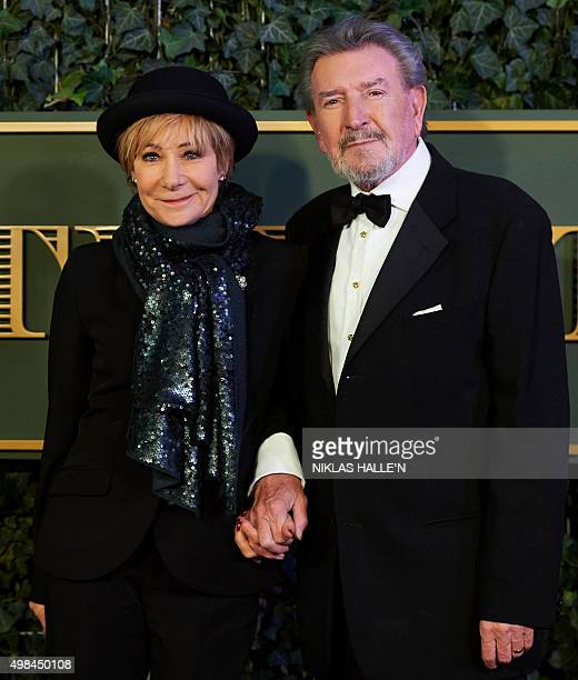 British actress Zoe Wanamaker and her actor husband Gawn Grainger pose on the red carpet as they attends the 61st London Evening Standard Theatre...