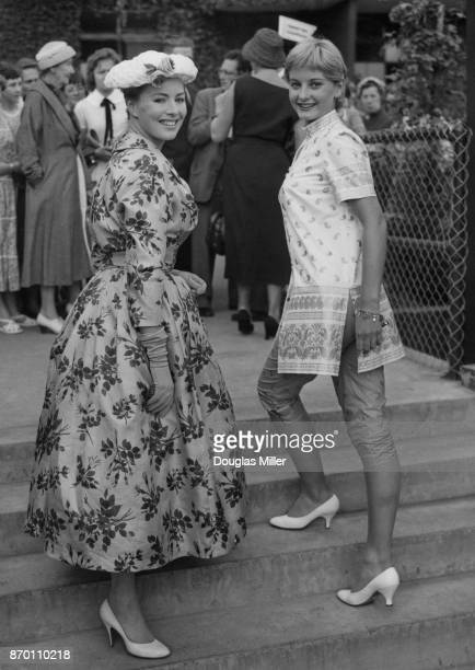 British actresses Beth Rogan and Jill Ireland attend the Wimbledon tennis championships London UK 26th June 1957 Ireland is wearing a jacket designed...