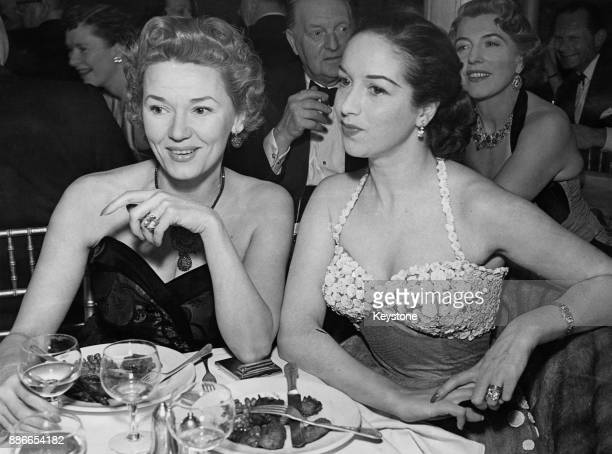 British actresses Gabrielle Brune and Pat Kirkwood watch a fashion show at Giros in London in aid of the Olympic Games Fund 25th March 1952 The...