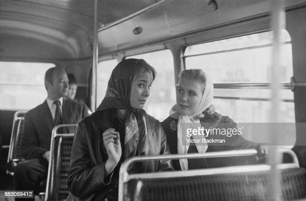 British actresses Juliet Mills and Julia Lookwood on a doubledecker bus in London UK 21st November 1960