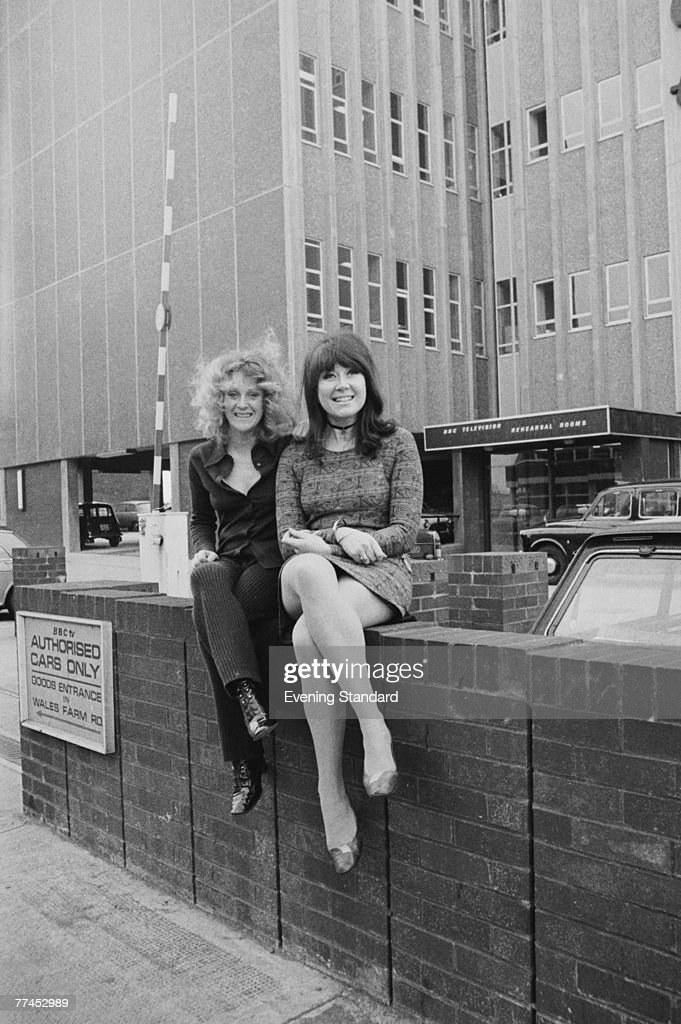 British actresses Polly James (left) and Nerys Hughes, the stars of British sitcom 'The Liver Birds', pose outside the BBC Television Rehearsal Rooms on Victoria Road, London, 4th February 1971.
