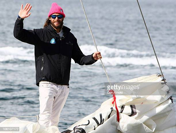British adventurer and environmentalist David de Rothschild waves to the media as the Plastiki arrives at Sydney Harbour completing the 12860...