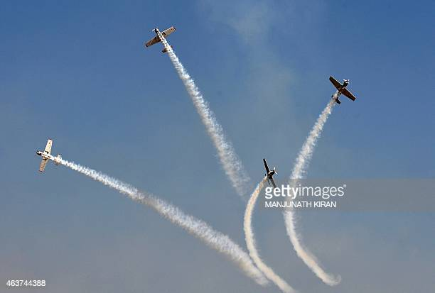 A British aerial formation team perform stunts at Yelahanka Airforce Station in Bangalore on February 18 on the inaugural day of Aero India 2015...