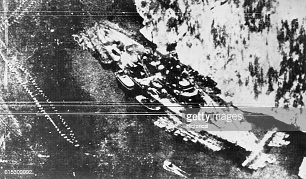 A British aerial reconnaissance shot of the German battleship Tirpitz stationed at Trondheim Norway in wait for Russian convoys April 1942