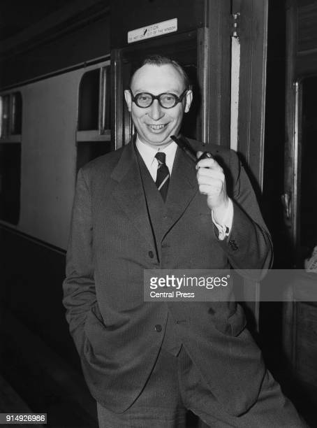 British aeronautical engineer Arnold Alexander Hall Technical Director of the Hawker Siddeley Group leaves Euston Station in London for Canada 20th...