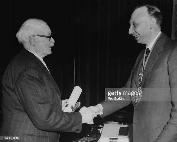 British aeronautical engineer Gustavus Green receives the Honorary Companionship of the Royal Aeronautical Society from Sir Arnold Alexander Hall...