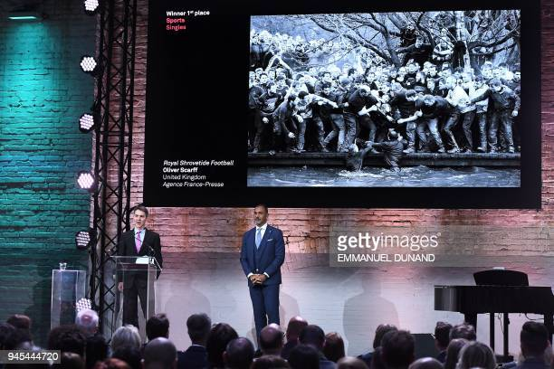 British AFP photographer Oliver Scarff speaks next to Dutch former football player Ruud Gullit in Amsterdam on April 12 2018 during the 2018 World...