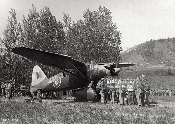 A British aircraft loaded with arms and munitions is welcomed by partisans at Cortemilia airport Cuneo 1945