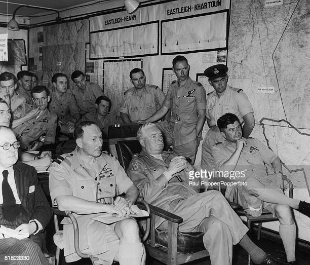British Airforce officers at a briefing in Nairobi Kenya prior to a bombing raid by Lincoln bombers on MauMau rebel targets near Eburru and the...