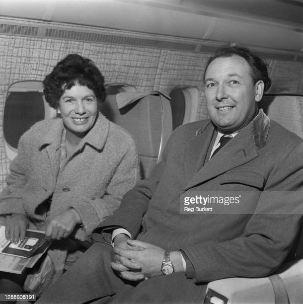 British airline entrepreneur Freddie Laker with his wife Joan on a British United Airways flight, 20th November 1965.