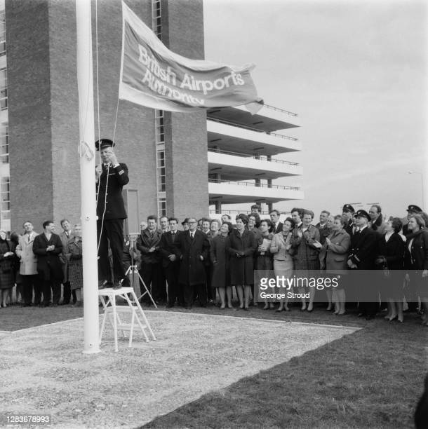 British Airports Authority flag being raised at London Airport, UK, for the arrival of BAA chairman Peter Masefield, 1st April 1966. The BAA later...