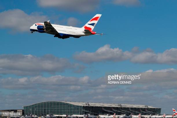 A British Airways A380 takes off over Heathrow's airport terminal 5 in west London on March 16 2020 IAG the owner of British Airways and Spanish...