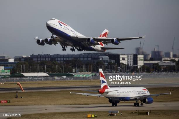A British Airways aeroplane takes off from the runway at Heathrow Airport's Terminal 5 in west London on September 13 2019