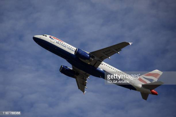A British Airways aeroplane takes off from the runway at Heathrow Airport's Terminal 5 in west London on September 13 2019 British Airways has...