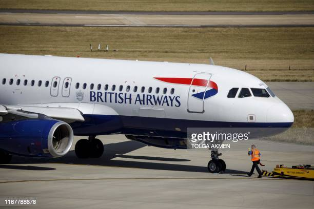 A British Airways aeroplane taxis on the runway at Heathrow Airport's Terminal 5 in west London on September 13 2019