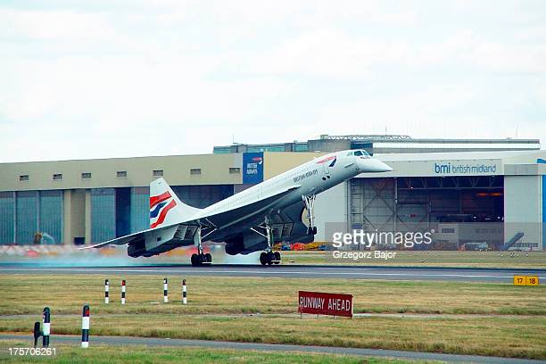 CONTENT] British Airways AerospatialeBAC Concorde 102 GBOAC touching down on runway 27R at London Heathrow UK England September 7 2002
