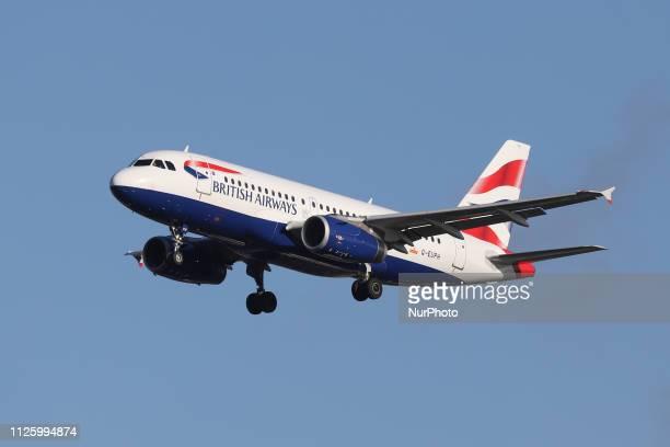 British Airways Airbus A319100 with registration GEUPH landing at London Heathrow International Airport LHR / EGLL in England UK British Airways BA...