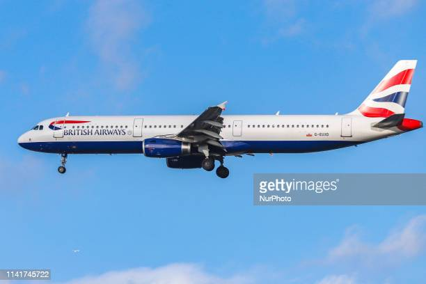 British Airways Airbus A321231 airplane with registration GEUXD landing at the Dutch capital Amsterdam AMS EHAM Schiphol International Airport in the...
