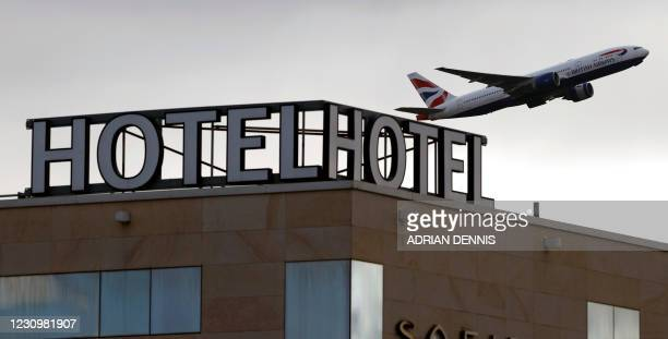 British Airways aircraft is pictured as it takes off from behind the Sofitel hotel at Terminal 5 of London Heathrow Airport in west London on...