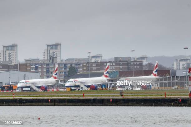 British Airways aircraft lay idle at London City Airport as the UK enters stricter lockdown measures on January 5, 2021 in London, United Kingdom....