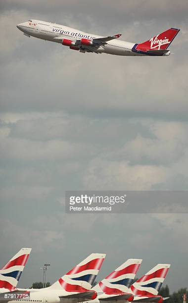 British Airways aircraft line up under the flight path at Heathrow Airport on May 22 2009 in London The United Kingdom's largest airline has...