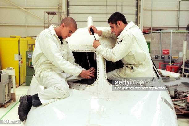 British Airways aircraft maintenance trainees working on a Hawker Siddley 125 jet Barry College Vale of Glamorgan South Wales