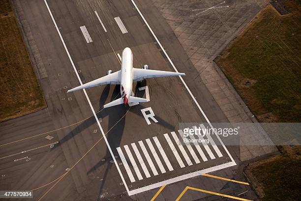 A British Airways aircraft operated by British Airways Plc prepares to takeoff from the end of the north runway at London Heathrow Airport in this...