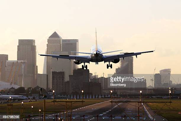 A British Airways aircraft operated by British Airways Plc prepares to land at London City Airport near to the Canary Wharf business financial and...