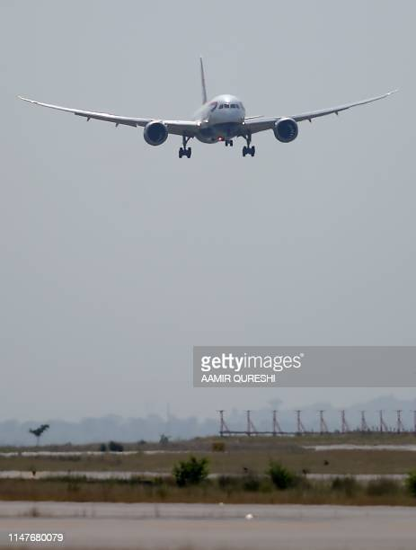 A British Airways aircraft prepares to land on a runway at the Islamabad International Airport on the outskirts of Islamabad on June 3 2019 British...