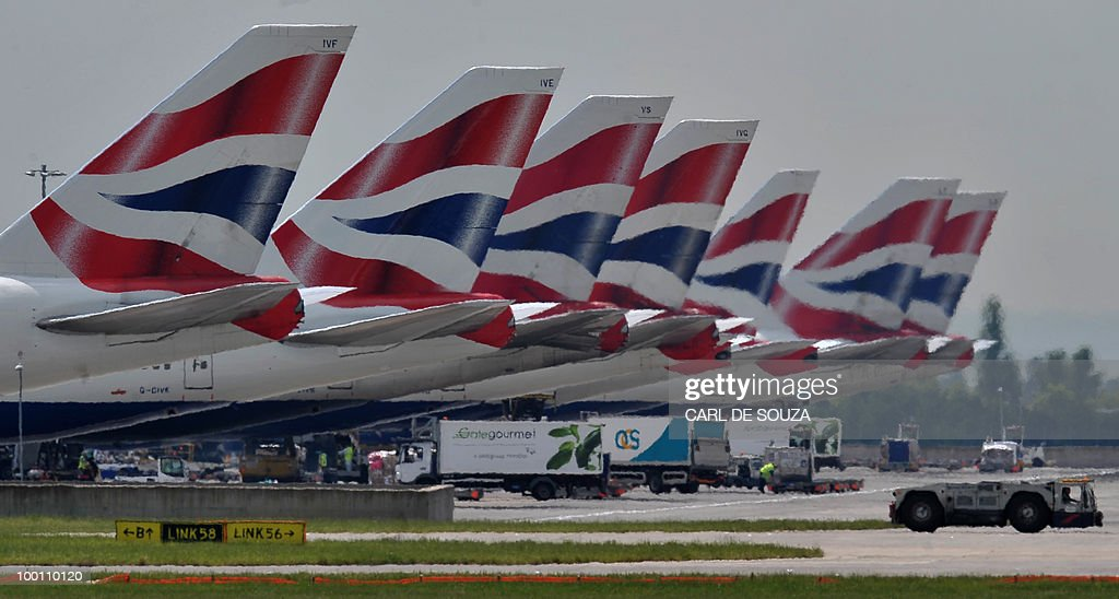 A British Airways aircraft sit parked at Terminal 5 of Heathrow Airport in west London on May 21, 2010. British Airways on Friday posted a record annual pre-tax loss of 531 million pounds (609 million euros, 765 million dollars) on slumping sales but forecast it would break even this year. BA, which faces a cabin crew strike next week, said its net loss widened to 425 million pounds in the 12 months to March from 358 million pounds in the previous year. Revenues tumbled 11.1 percent to 7.99 billion pounds.