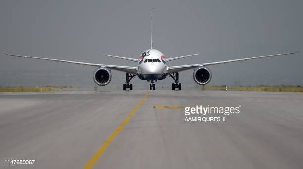 A British Airways aircraft taxies on a runway with the Pakistani and Union Jack flags upon landing at the Islamabad International Airport on the...