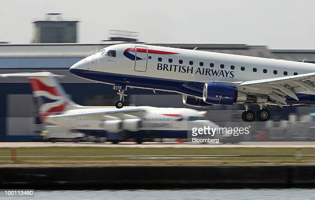 A British Airways airplane comes into land at City Airport in London UK on Friday May 21 2010 British Airways Plc said it will break even this year...