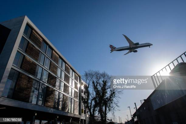 British Airways airplane flies over a Travelodge hotel as it comes in to land at Heathrow Airport on January 25, 2021 in London, England. The mayor...