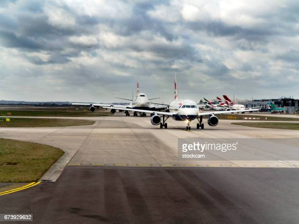 British Airways airplane queueing on runway