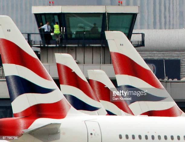 British Airways' airplanes sit on the runway at London City Airport on March 17 2010 in London England Unite Union leaders are due to talk with with...
