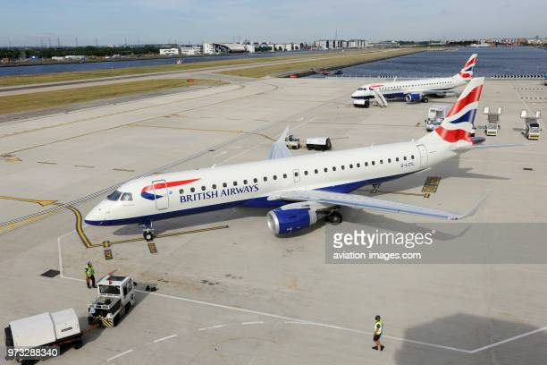 British Airways BA CityFlyer Embraer 190LR taxiing with Embraer 190 parked behind at London City