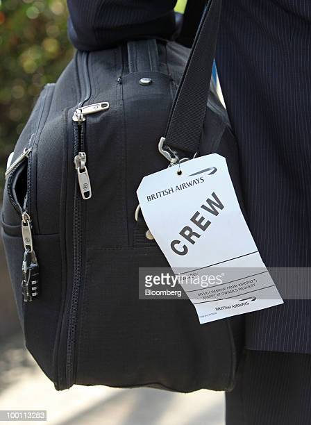 A British Airways baggage tag hangs from a crew member's luggage at City Airport in London UK on Friday May 21 2010 British Airways Plc said it will...