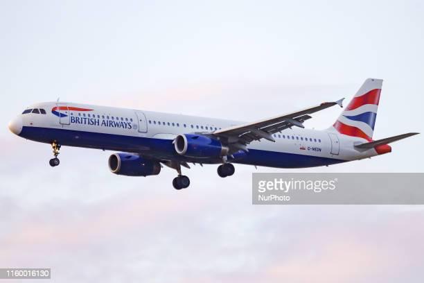 British Airways BAW BA Airbus A321200 aircraft landing at runway 27R at Heathrow International Airport LHR EGLL in England UK during a summer evening...